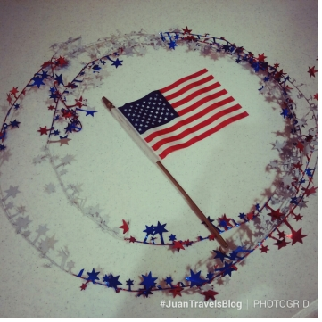 the American flag surrounded by star confetti